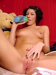 Naughty brunette touching her plump jugs