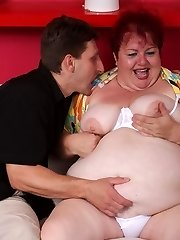 Sensual mature redhead Margaret lures her neighbor into harpooning her fat pussy on the couch