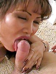 Hot matured Asian sucking stiff cock