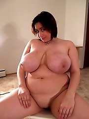 Young fat tart licks her own boobs and shows pussy