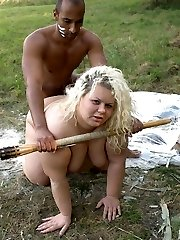 Huge blonde Amanda on her knees while a black guy speared her pussy with his wang
