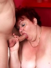 Chunky mature redhead Margaret spreading her meaty thighs and taking a huge cumshot