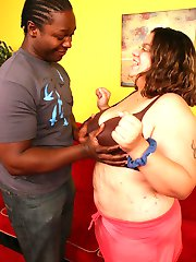 Smoking hot clip of BBW Jewelz naked while slurping a huge black dick before taking it in her...