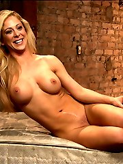 Blonde All-American beauty Cherie starts in a standing spread with her arms harshly bound in...