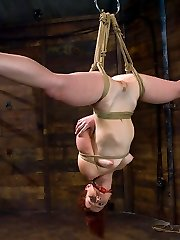 Trinity Post is not only handsome and limber, she's also one of the messiest tramps around. Claire Adams vocally humiliates this redheaded slut while she is roped helpless in restrain bondage with her tits clipped and her vagina wired. She is then put in an inverted suspension which leaves both her holes open to be stuffed with electric metal corks. She jizzes uncontrollably upside down until she is praying for the pleasure to stop. But of course, that isn't enough to please this tiny mega-slut, so Claire strap-on pounds her in the ass and slams a fist deep in her cunt. And that is just the first three sequences!!!!