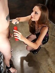 With his cock and ball-sac exhausted to a bondage bed, Mistress Mona pours hot wax all over them.  She continues her slave's torment with a wartenberg wheel and by caning his cock.  For his prize she allows him to wank off in front of her, the only problem is, his manstick and nut are to sore for him to jizz.