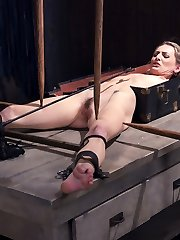 Natasha is not only into being tormented, but she actually makes it a sexual experience. She finds sheer pleasure in suffering. The pain makes her smile and the bondage makes it even nicer. She commences with her torso locked in a foot locker and her lower half is fully exposed with wooden stakes holding her in place. Next we have Natasha in a getting down on all fours position, her palms in a grueling strappado, her neck in in a steel cangue that is bolted to a wooden post, and her gams spread. We get to witness exactly how much pain she can endure and keep that sneer on her face. She screams in agony from the torment, and her pussy gushes when the vibe is applied.Eventually she is on her back with her arms and legs pulled up leaving her completely defenseless and vulnerable. Her feet are destroyed with brutal bastinado before her vag is ravished and she is made to ejaculation madly.