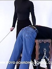 Nasty lad bent over the trestle with his pants down - hard caning from cruel blonde bitch
