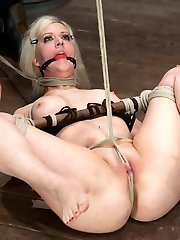 We start out giving bondage instruction to the members as we bind Cherrys knees and hands to a...