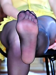 Footsie gal dangles her shoe before showing her painted toes thru pantyhose