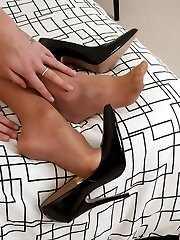 Sophie teases, tearing the pantyhose from her feet!