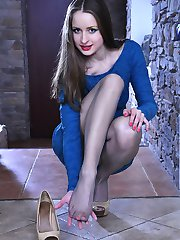 Adorable girl slides out of her hot pumps showing her nyloned feet close-up