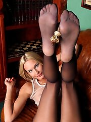 Blondie preparing to play chess with her delicious feet clad in black hose