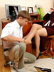 Kinky co-worker worshipping nyloned feet of cute chick during lunch break