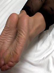 blonde making hot footjob in nylons