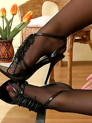 Curvaceous chick in control top pantyhose playing with foot embellishment