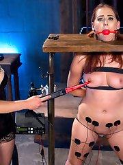 Big Booty Dominatrix Juliette March breaks in rookie electroslut Aali Rousseau with bondage,...