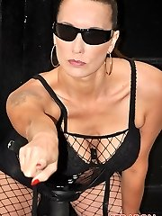 Strapon Jane sports her summer black shades with black lingerie and a big dark-hued strapon cock