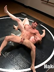 This isn't the first time that Cass Bolton and Billy Santoro have faced off. Their football teams met in the championship game but it was Billy's side that took the victory. Now the two rivals go at it on the mat padded up and with hard cocks. The muscle bound studs slam each other around before taking the pads off and fighting to shove their cock in the other's mouth. The loser gets smacked down, made to suck cock and a hard ass fucking while the winner covers him in cum.