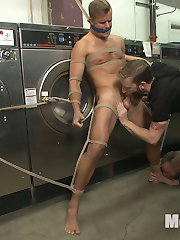 It's a quiet day at the laundromat -- just Connor Patricks and two pervs who won't stop checking him out. Connor's ass bent over a dryer becomes too tempting, so Jessie and Sebastian nab the hottie and tie him up right there in the laundromat. He struggles against the ropes as his captors strip him down and play with his cock. Soon, Connor begs not to be let go, but instead to get off, as Jessie sucks on Connor's raging boner and Sebastian presses two hitachis over Connor's balls and taint. After a vicious tickling, Jessie and Sebastian move Connor to a laundry cart, tying his ankles above his head. With his ass wide open, Connor has his prostate pounded with a vibrating dildo. His captors trade the vibrator for two more dildos, spitroasting the boy and having him eat Jessie's ass. Each edge becomes more painful for Connor's dick as it bulges under a tight cockring. By the time Jessie and Sebastian allow Connor to cum, the boy shoots a thick load all over himself. After getting a taste of his own cum, Connor takes an apple polishing and is left in ropes as Jessie and Sebastian leave to let the spin cycle finish.