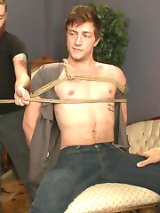 Logan Taylor feels a little nervous about his first time with KinkMen, but his anxieties turn to horny anticipation as he watches Jessie and Sebastian fit his body in rope. Tied to a chair on a spinning platform, Logan decides to enjoy the ride. Jessie slices off Logan's briefs to reveal a huge, throbbing cock and gets to work stroking it. The two spin Logan between another, taking turns tweaking his sensitive nipples and edging his thick member. Logan is ready to blow when they bring out the fleshjack, but Jessie pulls it away to leave Logan spinning and frustrated. Next thing Logan knows, he splayed out and gagged on a couch as Jessie sucks him to the edge. Logan has his feet worshipped and his ass filled with a dildo. Logan likes the fucking a little too much, so Jessie trades the dildo for a prostate massager and denies two more orgasms from the boy. Logan can't take much more of this torment as he begs to cum though his gag. Jessie finally relents and i'll descibe the cum here.