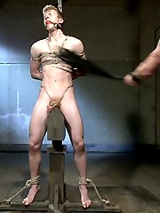 House dom Adam Herst awaits on his throne as slave #860 crawls towards him.  Mr Herst inspects the boy and reveals his cock and balls locked in chastity.  860 has his ass cropped before having the metal hook shoved up his hole.  The muscled dom orders his slave to worship his leather, starting from his boot all the way up to his cock.  After swallowing Mr Herst's cock, 860 takes his master's cock from behind with the ass hook still in place.  On the impaler, 860 endures the flogger before he's taken to his master's dungeon bed.  Suspended over the bed, 860 has his hole plugged and his cock tormented with the zapper.  Mr Herst removes the boy's chastity and plug and gives him one more fuck before giving the boy a face full of cum and ordering 860 to cum on his boot.