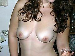 Brunette Woman Wearing Glasses Models Nude
