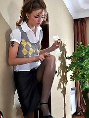 Tipsy girl unbuttons her skirt and rams a dildo thru her open crotch hose