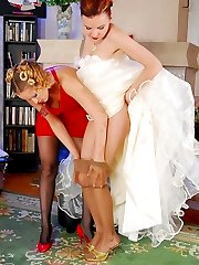 Blonde bridesmaid in black hose consoling a bride with sizzling French love