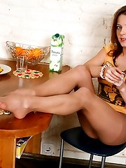 Doll-faced chick embellishing her nyloned feet with her beloved bracelet