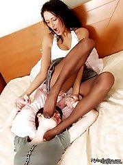 Upskirt babe teasing hot gal with her seductive feet clad in tan pantyhose