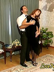 Sexy gal in black evening dress and matching stockings gets hot after-party
