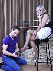 Shoe dangling hottie gets her nylon clad feet creamed after kinky foot sex