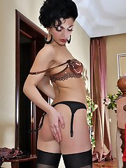 Stunning babe changes into a set of see-thru lingerie and black stockings