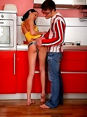 Lustful brunette fucked with a stud at the kitchen. Horny man wanted her ass, so much he licked...