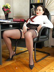 Cute secretary in back seam stockings caressing her pink before hot legjob
