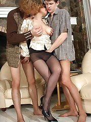 Vivacious brunette playing with rocky cocks clad in pantyhose in wild 3some