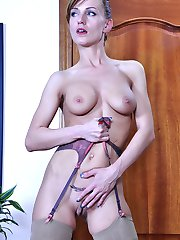 Heated chick parts her slim stocking-clad legs and stuffs a huge dildo toy