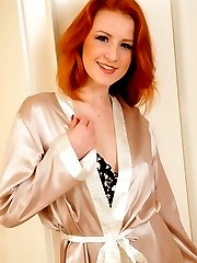 Fiery redhead Scarlot Rose in silk lingerie and stockings