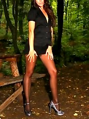 Cute brunette Natalia wearing miniskirt and black pantyhose.