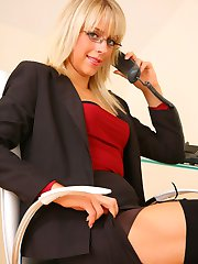Blonde beauty Charlotte J looks delightful as she seductively teases her way out of her sexy secretary outfit