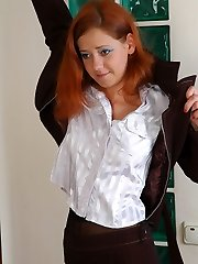 Red-haired chick takes out and tries on her freshly bought ebony shaping hosepipe
