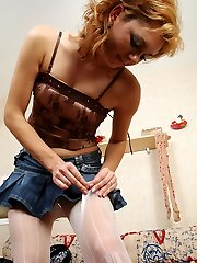 Funky redhead attempts on her denim mini-skirt with various sugary fashion hose