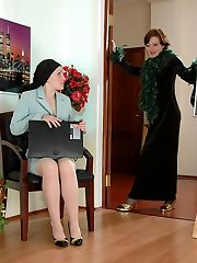 Black-stockinged lady-manager going down on her fetching nyloned assistant
