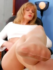 Angel at the office in suntan Leggs stockings