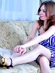 Teasing girl in lacy nylons with a satin garter showing off her tasty buns
