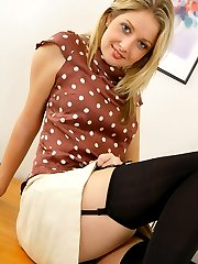Stunning secretary Nikki F in smart suit with black lingerie and stockings.