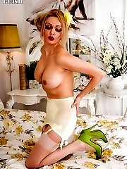 Blonde Amber Jay in full cup bra and lemon girdle is femininity personified!