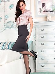 Sophia is a lady in control. Her body, her lingerie, her sheer black fully fashioned nylon legs...