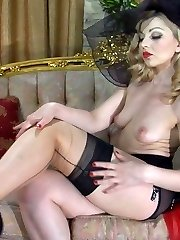 Fancifully dressed glam babe changes into reinforced red-n-black stockings